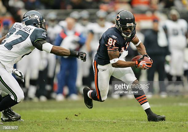 Wide receiver Rashied Davis of the Chicago Bears carries the ball against safety Jordan Babineaux of the Seattle Seahawks during their NFC Divisional...