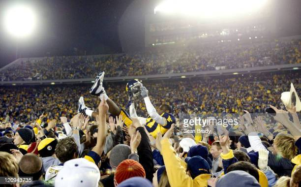 Wide Receiver Rayshawn Bolden is hoisted high above the swarming crowd in celebration of West Virginia's win over Virginia Tech at Morgantown West...