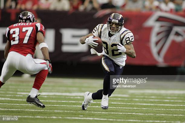 Wide receiver Reche Caldwell of the San Diego Chargers carries the ball against cornerback Aaron Beasley of the Atlanta Falcons during the game on...