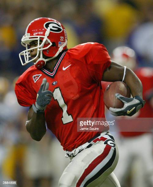 Wide receiver Reggie Brown of the Georgia Bulldogs runs the ball after a catch during the game against the LSU Tigers in the SEC Championship Game on...