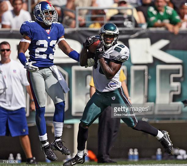 Wide receiver Reggie Brown of the Philadelphia Eagles hauls in a pass for a touchdown while being defended by cornerback Corey Webster on September...