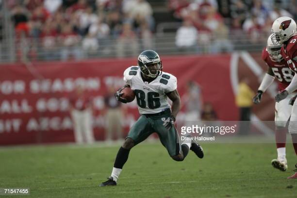 Wide Receiver Reggie Brown of the Philadelphia Eagles runs with the ball on December 24 2005 at Sun Devil Stadium in Tempe Arizona The Cardinals...