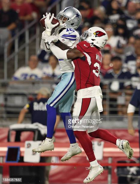 Wide receiver Reggie Davis of the Dallas Cowboys makes a 32-yard reception over strong safety Shawn Williams of the Arizona Cardinals during the...