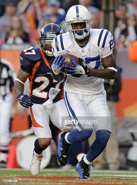 Wide receiver Reggie Wayne of the Indianapolis Colts catches a touchdown pass against cornerback Darrent Williams of the Denver Broncos in the third...