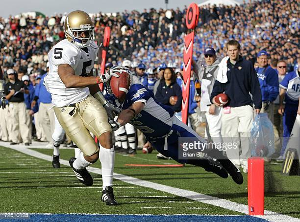 Wide receiver Rhema McKnight of the Notre Dame Fighting Irish eludes the grasp of Chris Sutton the Air Force Falcons for a touchdown in the first...