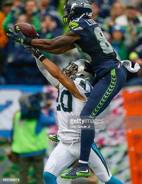 Wide receiver Ricardo Lockette of the Seattle Seahawks makes a catch for a touchdown against defensive back Kurt Coleman of the Carolina Panthers in...