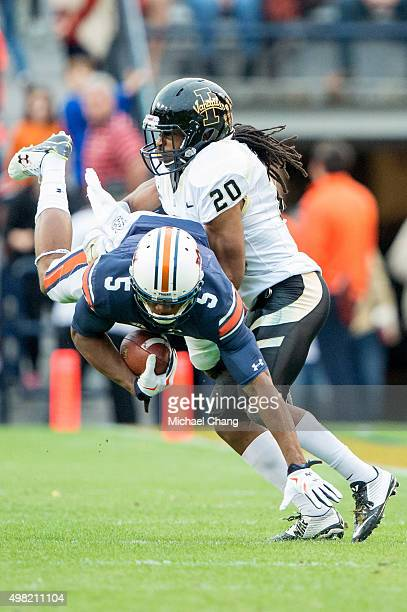 Wide receiver Ricardo Louis of the Auburn Tigers dives while being tackled by corner back Dorian Clark of the Idaho Vandals on November 21 2015 at...