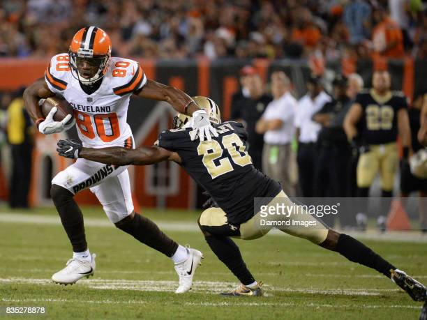Wide receiver Ricardo Louis of the Cleveland Browns breaks the tackle of cornerback Ken Crawley of the New Orleans Saints in the second quarter of a...