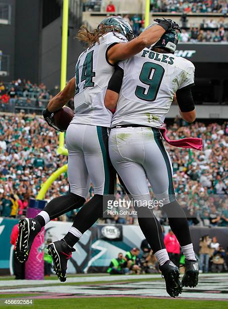 Wide receiver Riley Cooper and quarteback Nick Foles of the Philadelphia Eagles react after scoring a touchdown in the second quarter against the St...