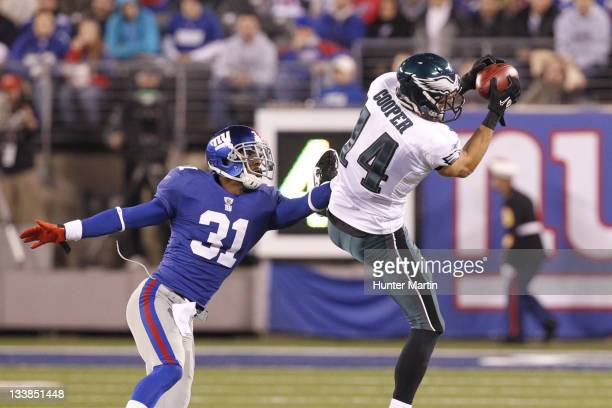Wide receiver Riley Cooper of the Philadelphia Eagles catches a pass as cornerback Aaron Ross of the New York Giants defends during a game on...