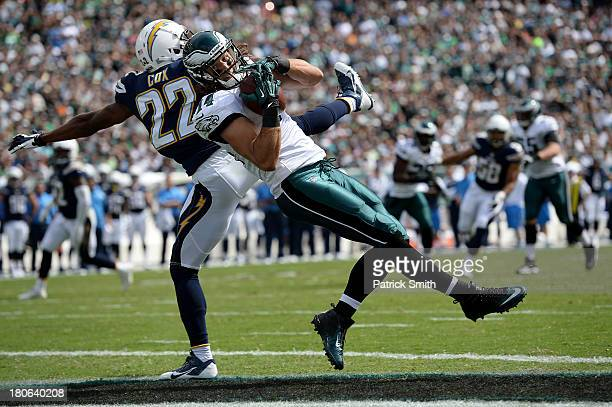 Wide receiver Riley Cooper of the Philadelphia Eagles catches a pass past cornerback Derek Cox of the San Diego Chargers in the second quarter for a...