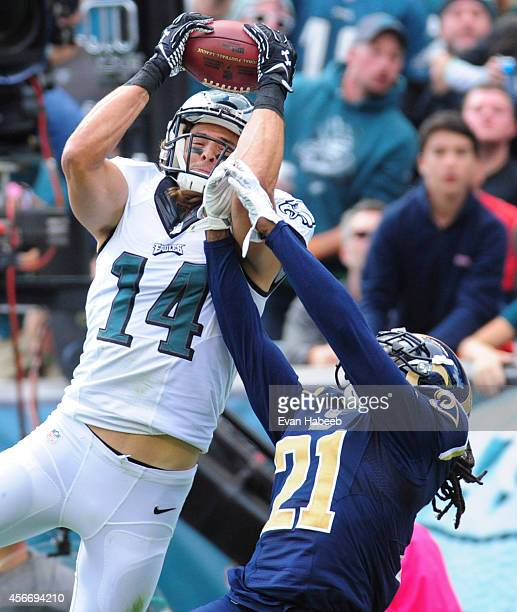 Wide receiver Riley Cooper of the Philadelphia Eagles catches a touchdown pass with Janoris Jenkins of the St Louis Rams defending on the play in the...
