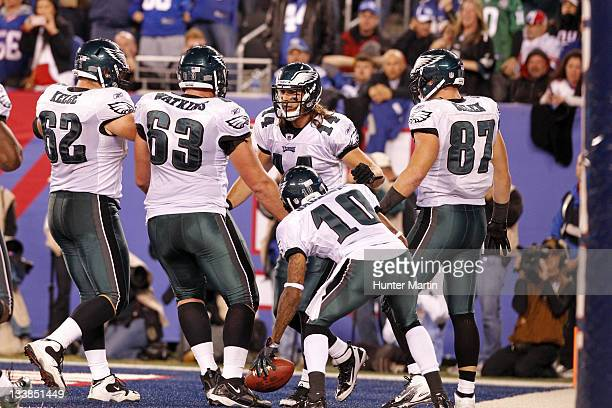 Wide receiver Riley Cooper of the Philadelphia Eagles celebrates with his teammates after catching a game winning touchdown during a game against the...