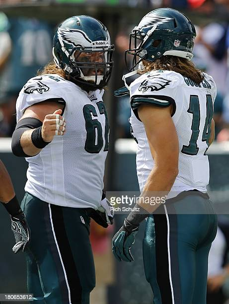 Wide receiver Riley Cooper of the Philadelphia Eagles is congratulated by teammate Jason Kelce after Cooper caught a 13 yard touchdown pass during...