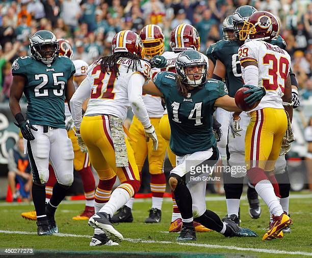 Wide receiver Riley Cooper of the Philadelphia Eagles reacts after making a catch at the one yard line as safety Brandon Meriweather and cornerback...