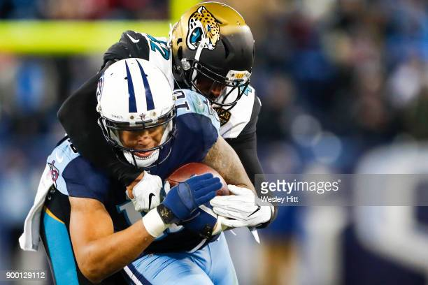 Wide Receiver Rishard Matthews of the Tennessee Titans carries the call against Corner Back Aaron Colvin of the Jacksonville Jaguars at Nissan...