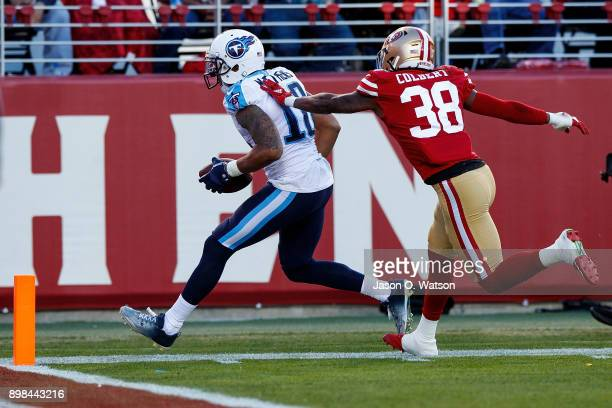 Wide receiver Rishard Matthews of the Tennessee Titans is pushed out of bounds by defensive back Adrian Colbert of the San Francisco 49ers during the...