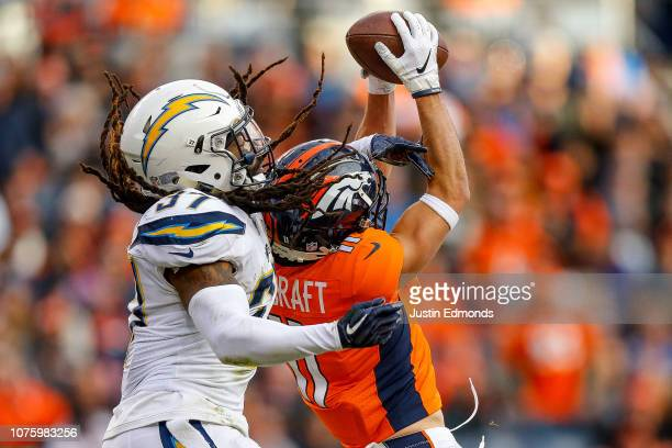 Wide receiver River Cracraft of the Denver Broncos comes up with a catch and first down under coverage by strong safety Jahleel Addae of the Los...