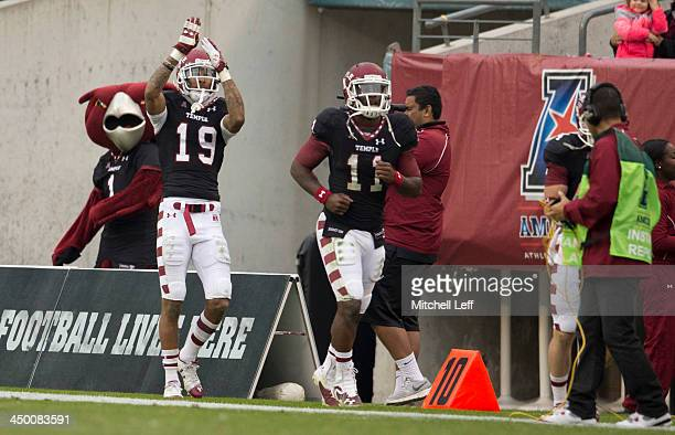 Wide receiver Robby Anderson and quarterback P.J. Walker of the Temple University Owls react to a touchdown pass against the University of Central...