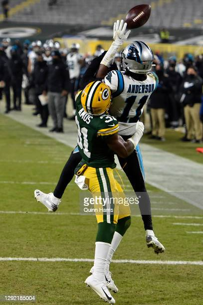Wide receiver Robby Anderson of the Carolina Panthers has a pass broken up by strong safety Adrian Amos of the Green Bay Packers in the fourth...
