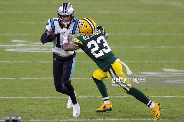 Wide receiver Robby Anderson of the Carolina Panthers is tackled cornerback Jaire Alexander of the Green Bay Packers in the fourth quarter of the...