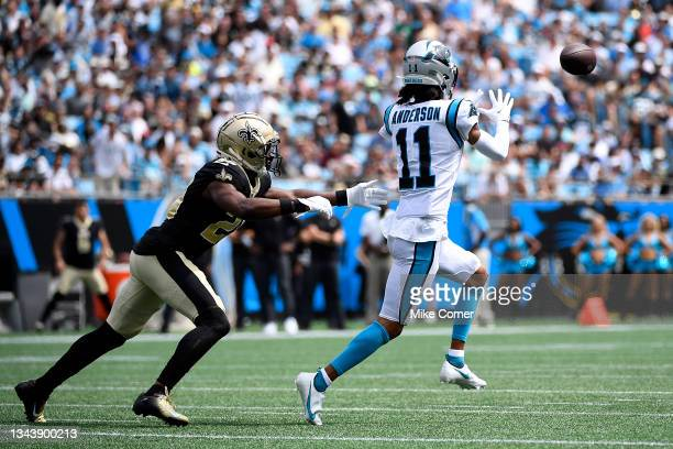 Wide receiver Robby Anderson of the Carolina Panthers makes a reception over cornerback Paulson Adebo of the New Orleans Saints for a first down...