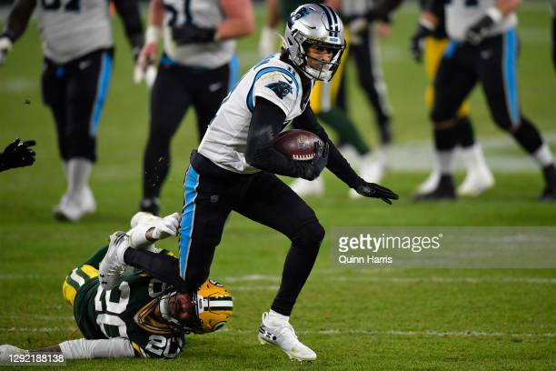 Wide receiver Robby Anderson of the Carolina Panthers rushes for a first down ageist the Green Bay Packers in the third quarter of the game at...