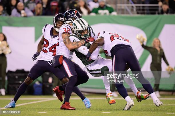 Wide receiver Robby Anderson of the New York Jets gets tackled by free safety Tyrann Mathieu and defensive back Andre Hal of the Houston Texans after...