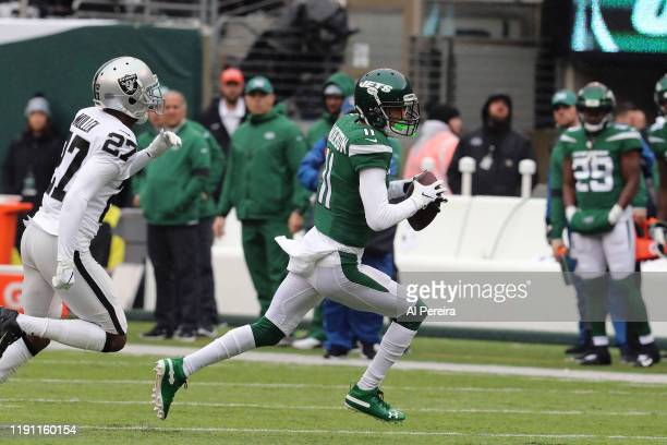 Wide Receiver Robby Anderson of the New York Jets has a long gain against the Oakland Raiders in the first half in the rain at MetLife Stadium on...