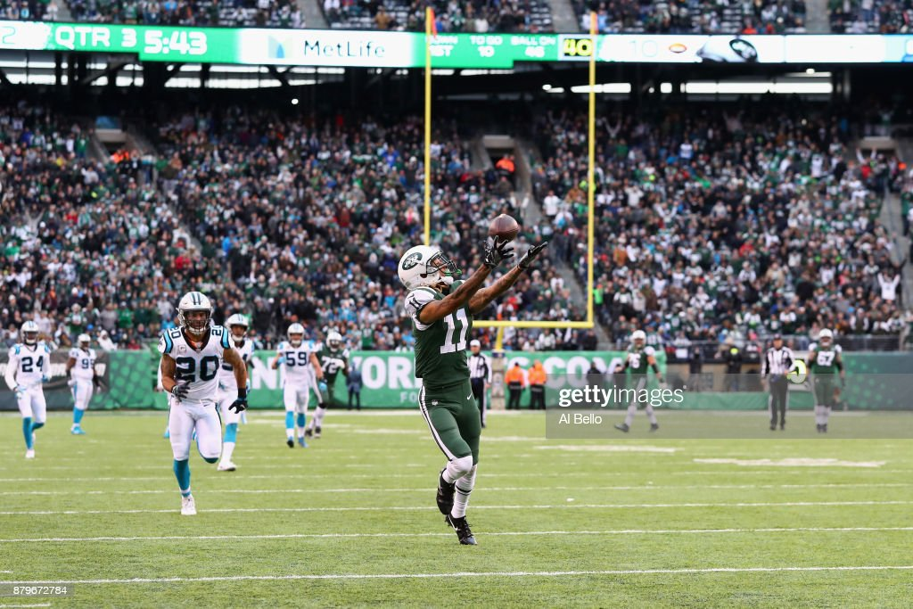 Wide receiver Robby Anderson #11 of the New York Jets reaches for a catch which lead to a touchdown during the third quarter of the game at MetLife Stadium on November 26, 2017 in East Rutherford, New Jersey.