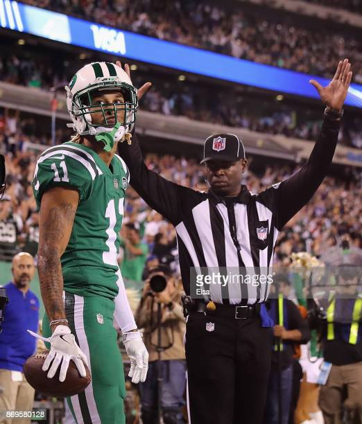 Wide receiver Robby Anderson of the New York Jets reacts after making a touchdown against the Buffalo Bills during the third quarter of the game at...