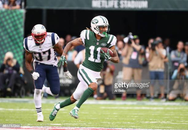 Wide receiver Robby Anderson of the New York Jets runs the ball against strong safety Jordan Richards of the New England Patriots during the second...