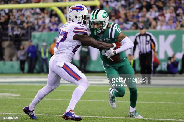 Wide receiver Robby Anderson of the New York Jets runs the ball against cornerback Tre'Davious White of the Buffalo Bills during the first half of...