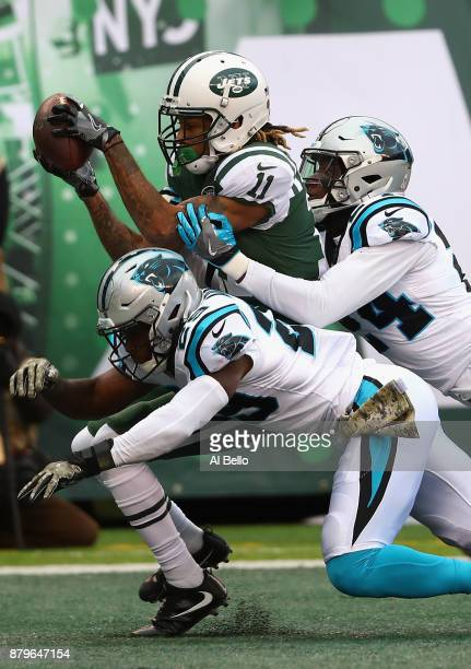 wide receiver Robby Anderson of the New York Jets scores a touchdown against strong safety Mike Adams and cornerback James Bradberry of the Carolina...