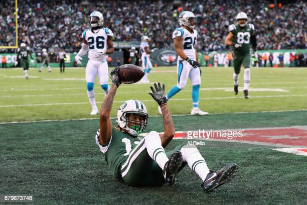Wide receiver Robby Anderson of the New York Jets scores a touchdown during the third quarter of the game at MetLife Stadium on November 26 2017 in...
