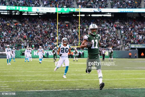 Wide receiver Robby Anderson of the New York Jets scores a touchdown during the third quarter of the game at MetLife Stadium on November 26, 2017 in...