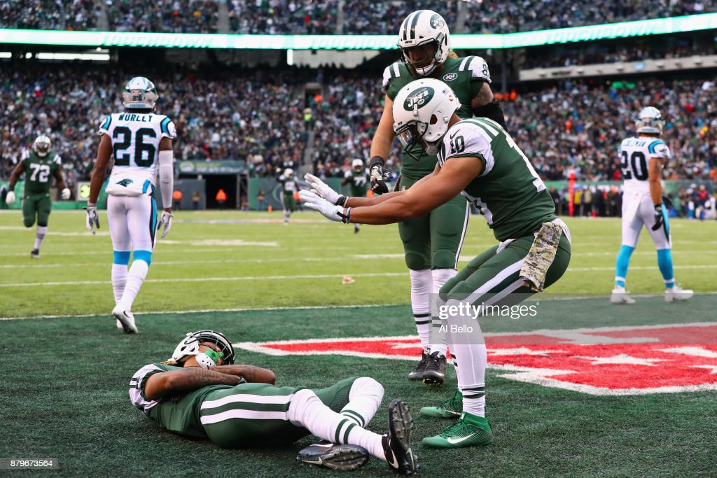 Wide receiver Robby Anderson #11, wide receiver Jermaine Kearse #10 and tight end Eric Tomlinson #83 of the New York Jets during the third quarter of the game at MetLife Stadium on November 26, 2017 in East Rutherford, New Jersey.