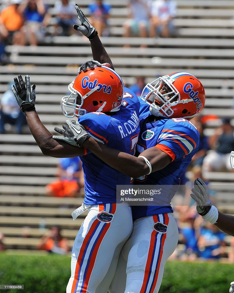Wide receiver Robert Clark #7 (left) of the Florida Gators celebrates a 39-yard touchdown catch during the Orange and Blue spring football game April 9, 2010 Ben Hill Griffin Stadium in Gainesville, Florida.