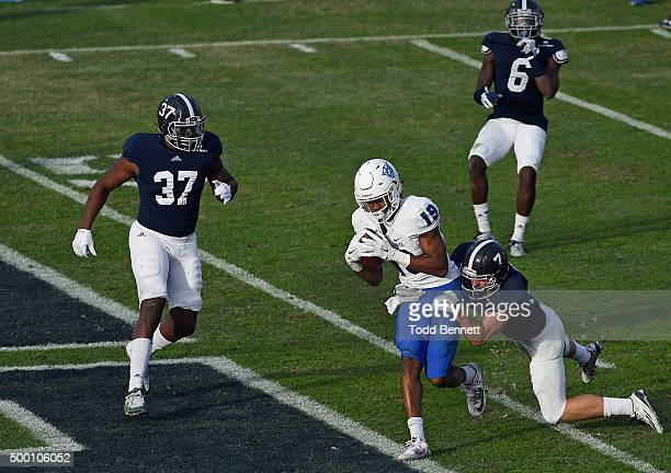 Wide receiver Robert Davis of the Georgia State Panthers scores a touchdown as he drags safety Matt Dobson of the Georgia Southern Eagles into the...