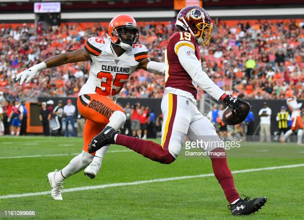 Wide receiver Robert Davis of the Washington Redskins scores a receiving touchdown in the first quarter of a preseason game against the Cleveland...