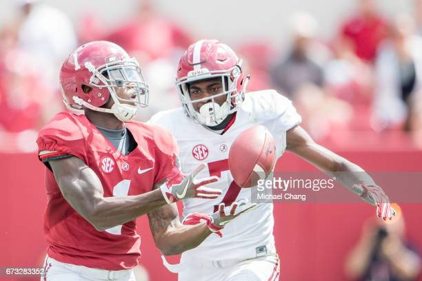 Wide receiver Robert Foster of the Alabama Crimson Tide attempts to catch a pass in front of linebacker Dylan Moses of the Alabama Crimson Tide at...