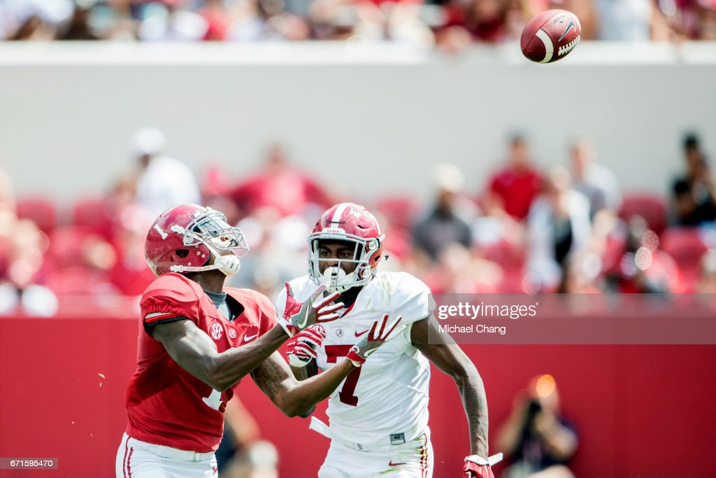 Wide receiver Robert Foster #1 of the Alabama Crimson Tide catches a pass in front of linebacker Dylan Moses #7 of the Alabama Crimson Tide at Bryant-Denny Stadium on April 22, 2017 in Tuscaloosa, Alabama.