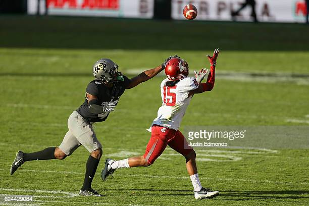 Wide receiver Robert Lewis of the Washington State Cougars makes a catch while being defended by defensive back Chidobe Awuzie of the Colorado...