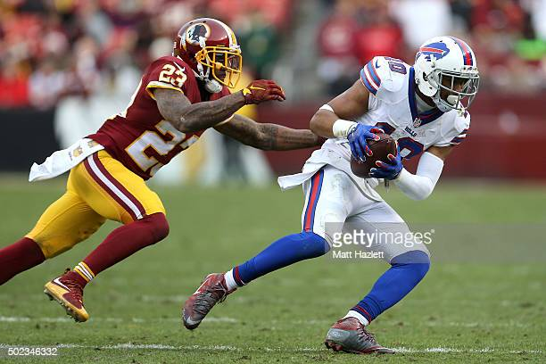 Wide receiver Robert Woods of the Buffalo Bills carries the ball against cornerback DeAngelo Hall of the Washington Redskins in the fourth quarter at...