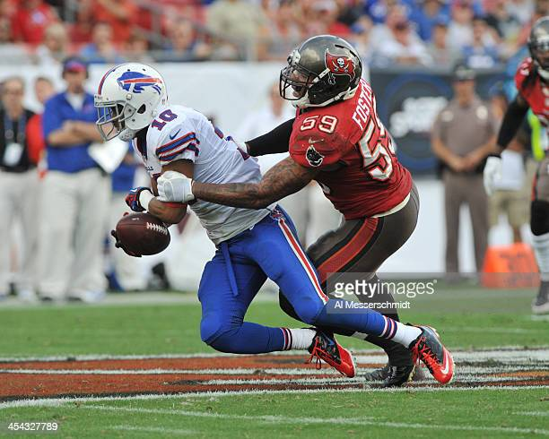 Wide receiver Robert Woods of the Buffalo Bills grabs a pass in front of linebacker Mason Foster of the Tampa Bay Buccaneers December 8, 2013 at...
