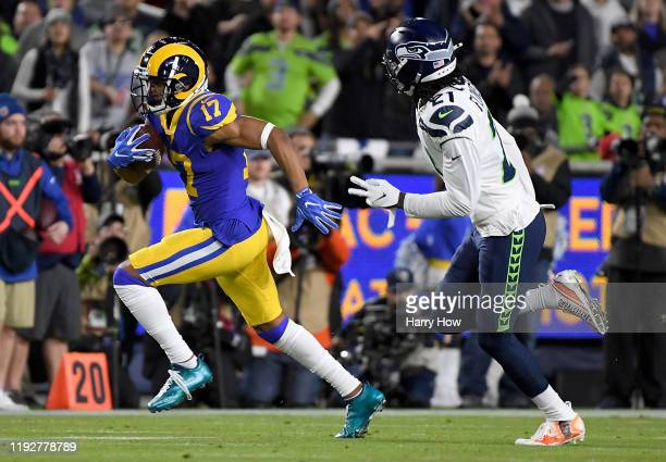 Wide receiver Robert Woods of the Los Angeles Rams carries the ball against the defense of cornerback Tre Flowers of the Seattle Seahawks during the...