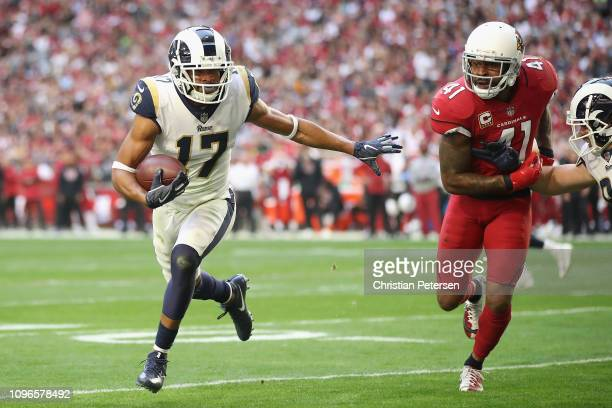 Wide receiver Robert Woods of the Los Angeles Rams carries the football past free safety Antoine Bethea of the Arizona Cardinals during the NFL game...