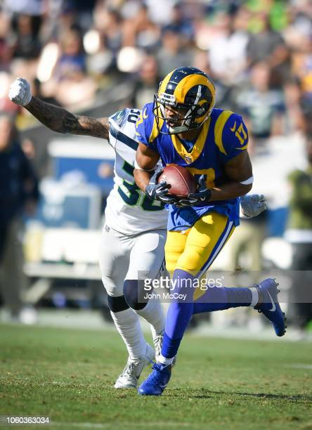Wide receiver Robert Woods of the Los Angeles Rams catches the ball in front of strong safety Bradley McDougald of the Seattle Seahawks at Los...