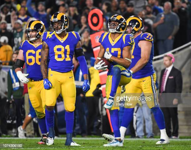 Wide receiver Robert Woods of the Los Angeles Rams celebrates his catch during the fourth quarter at Los Angeles Memorial Coliseum on December 16...