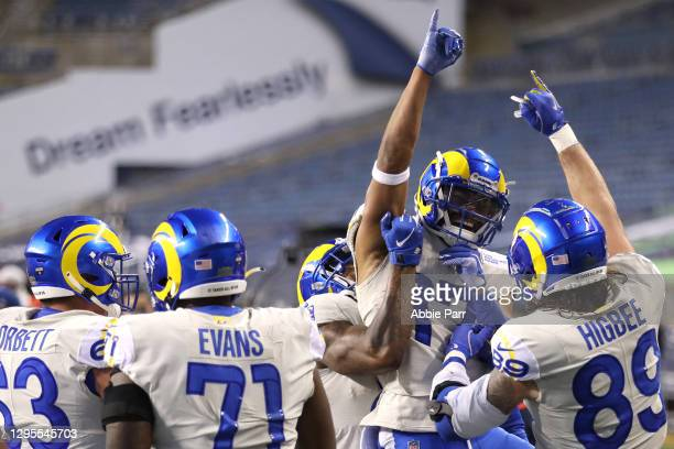 Wide receiver Robert Woods of the Los Angeles Rams celebrates with teammates after rushing for a touchdown during the fourth quarter of the NFC Wild...